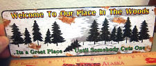 Novelty Metal Sign - Welcome to Our Place In The Woods - 10.5 x 3.5 inches