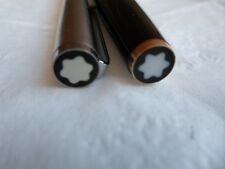 2 black and silver colored mont blanc fountain pens with 2 original cartridges