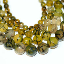 Achat Kugeln 6 - 16 mm facettierte Perlen grüngelb mit schwarzen Adern, 1 Strang