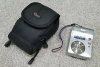 Nikon COOLPIX L3 5.1MP Digital Point and Shoot Camera - Silver, with belt bag.
