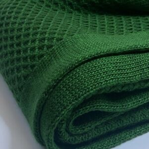 Green knitted throw blanket