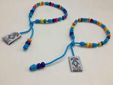 pulseras religiosas con cuentas de madera varios colores y santos hechas a mano