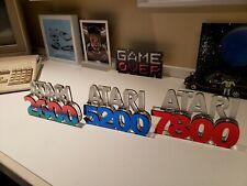All 3 display signs(Atari 2600,5200,7800 )(Atari show it off) great for gameroom