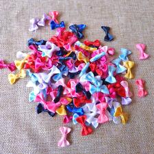 50 petits noeuds 2cm, coloris aléatoire