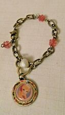 PRETTY DISNEY GOLD TONE PINK AND FAUX PEARL HEART AND PRINCESS CHARM BRACELET