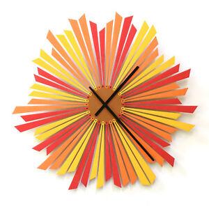 The Setting sun - elegant modern wall clock in red / orange by ardeola