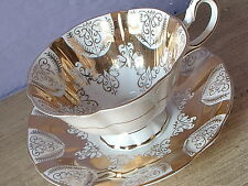 Vintage 1960's Queen Anne England Gold and White bone china tea cup teacup