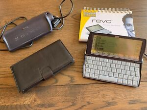 Vintage Psion Revo Palmtop with docking station, Leather Case & Charger.
