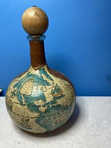 Wine decanter, Italy, wrapped in leather world map, over green glass