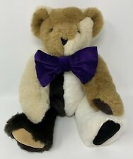 Vermont Teddy Bear Company Jointed Multicolored Bear Wearing Purple Flocked Bow