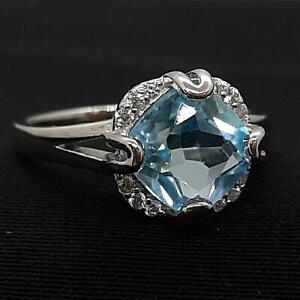World Class 2.70ctw Swiss Topaz & Diamond Cut White Sapphire 925 Silver Ring
