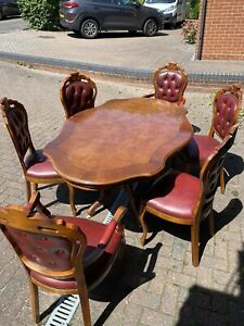 Ornate Italian wood Carved Pedastal Dining Table And Six Chairs