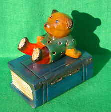 CHARACTER CARVING OF BEAR  SITTING ON A BOOK IN STAINED AND PAINTED WOOD