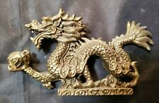 """CHINESE BRONZE FIGURINE - DRAGON CLUTCHING PEARL OF WISDOM - 2 3/4"""" BY 5"""" BY 1"""""""