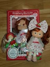 Original and New Strawberry Shortcake Berrykin dolls and Starlight Critter