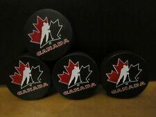"LOT OF 4 TEAM CANADA ICE HOCKEY OFFICIAL SOUVENIR PUCKS--""NEW"""