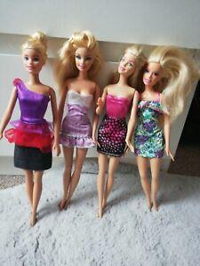 Modern Barbie Dolls in dresses clothes bundle