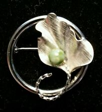 Vintage DEC Sterling pin. with a green stone.