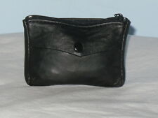A Small Soft Leather Key Coin Pouch With Front Pocket Zip Pocket And Keyring.