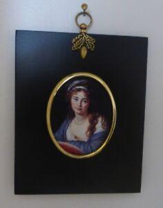 Portrait Miniature of unknown female in an acorn hanger black frame& brass bezel