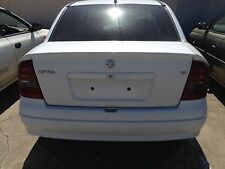 TS HOLDEN ASTRA SEDAN/Convertible TAIL LIGHT Pair Tinted Factory 1998 - 2005