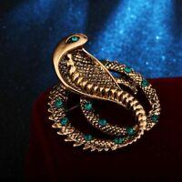 superbe broche cobra métal doré & strass vert