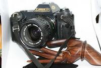 Vintage Canon T50 35mm SLR Camera w/ FD 35-70 mm F1:3.5-4.5 Lens & cover & bag