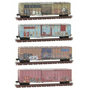 MICRO TRAINS 993 05 950 *BKTY* HEAVY WEATHERED 50' BOX CARS (4 PK)