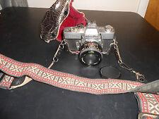 Used. SRT 102 35mm Minolta camera with F= 28 mm,1: 2.8 lens.