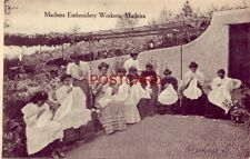 MADEIRA EMBROIDERY WORKERS nine women work on material