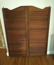Set of vintage wood louvered café bar saloon swinging doors