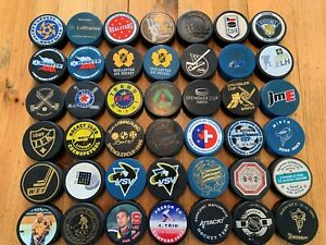 42- FOREIGN HOCKEY PUCKS
