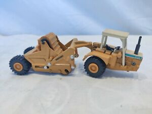ERTL Mighty Movers Dresser Scraper 412B, 1/64 scale. Nice. Eco shipping. Save.