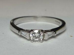 PLATINUM DIAMOND SOLITAIRE WITH DIAMOND SET SHOULDERS RING