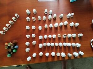 70 Thimbles assorted made of ceramic, porcelain, metal, wood and plastic.