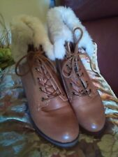 Ladies size 9, tan, brown, laced ankle boots. Cream faux fur cuff. Wedge heel