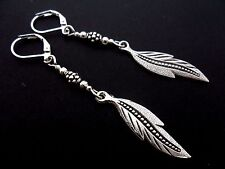 A PAIR OF  TIBETAN SILVER DANGLY  FEATHER THEMED LEVERBACK HOOK  EARRINGS. NEW.
