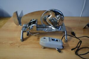 RIVAL ELECTRIC ADJUSTABLE CUT MEAT SLICER  #1101E/4