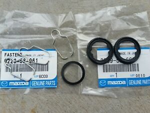Mazda 1200 1300 R100 lock clips and gaskets NEW