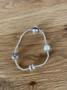 Pandora Silver Essence bracelet with 3 Silver Essence Charms
