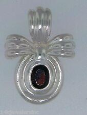 Sterling Silver CNA +-1.00 CT  Garnet Bow Tie Pendant