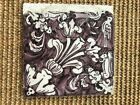 ANTIQUE 18C DUTCH DELFT MANGANESE TILE FEATURING BIRDS, FLOWERS, AND SQUIRRELS