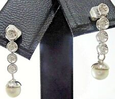Pendientes de oro blanco con 8 diamantes y perla natural