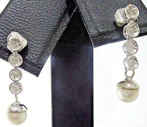 Pendientes de oro blanco con 8 diamantes y perla natural