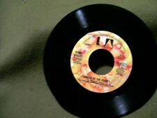 KENNY ROGERS 45 RECORD COWARD OF THE COUNTY & I WANT TO MAKE YOU SMILE 1979 UN A