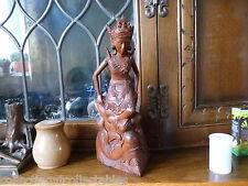Indonesian Boxwood Goddess Ratih rising from the mouth of demon Kala Rau