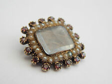 fine georgian gilt mourning brooch with braided hair amethyst and pearls