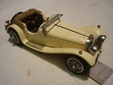 A Franklin mint scale model car of a 1938 Jaguar SS100, no box
