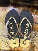 Bebe Women's Thong Flip Flops Sandals Slides Size 9 US Black and Gold Beach
