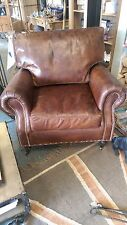 A Vintage Brown Leather Chair with Studs on Casters Leather Arm Chair